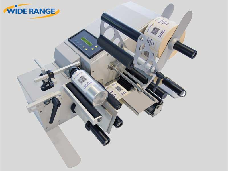 WIDE RANGE - Etichettatrice semiautomatica per prodotti cilindrici DWR ROUND